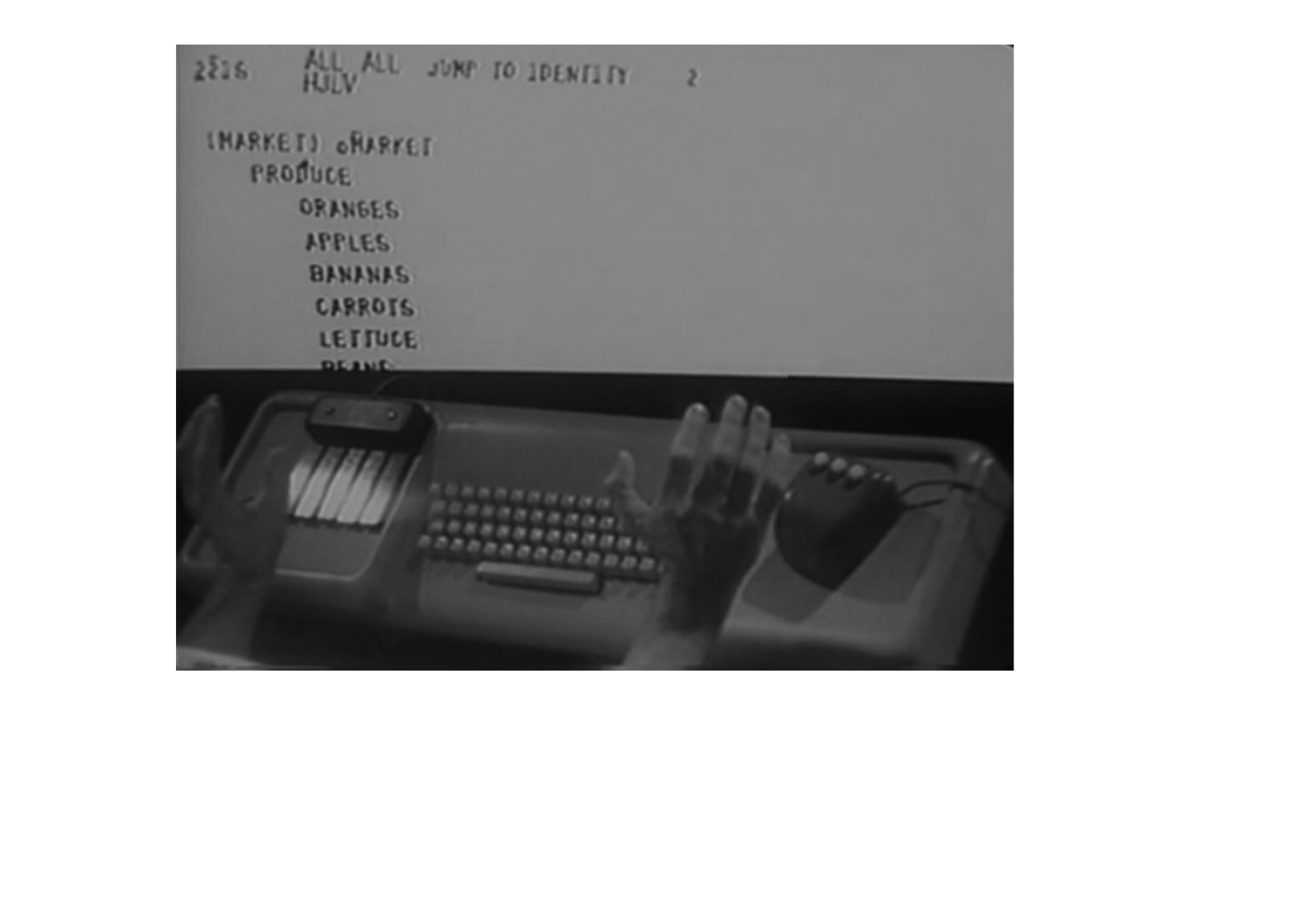 "A mouse, keyboard and collaborative text-editing demonstrated in Douglas Englebart's ""Mother of All Demos"", 1968"